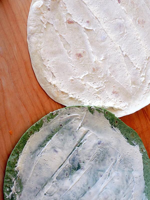 Spread Cream Cheese on Ham & Cheese Pinwheels