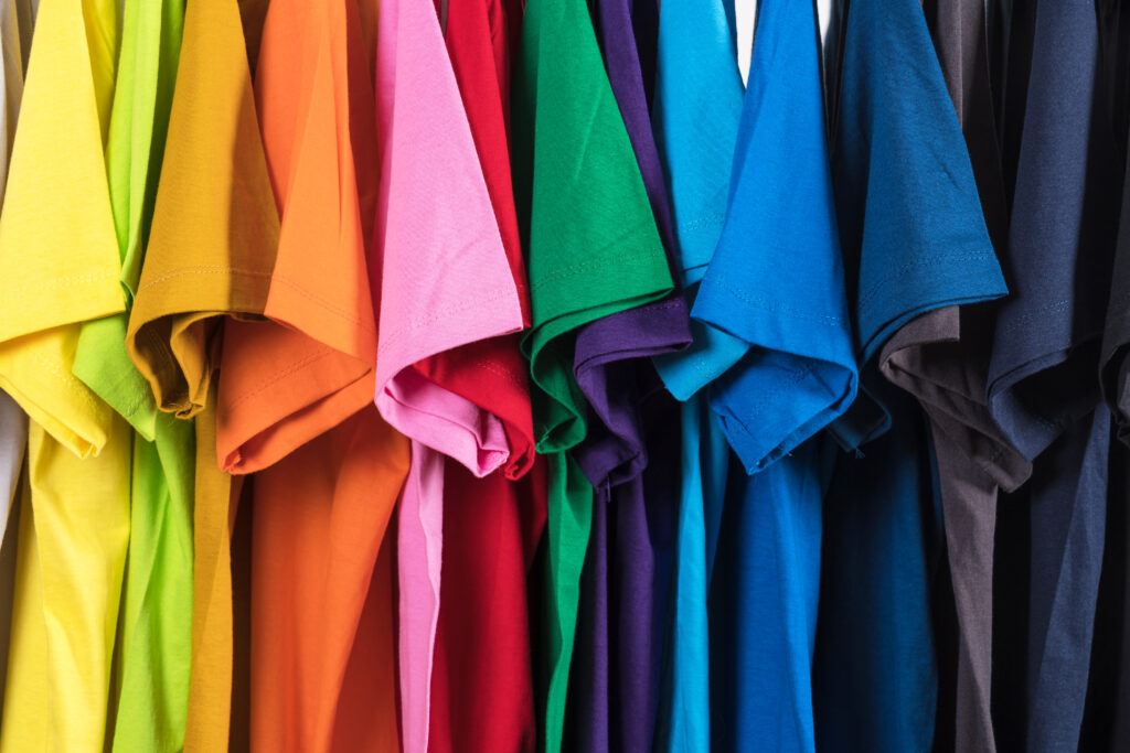multi-colored t-shirts hanging in a row