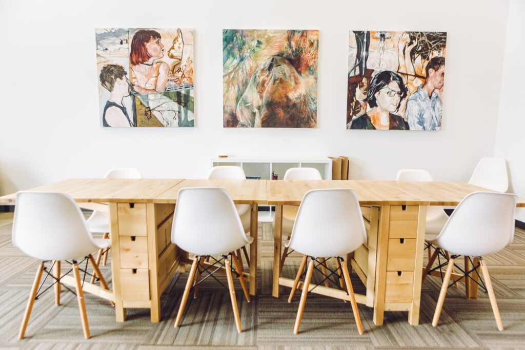 cheap canvas prints on a wall with a table and chairs in front