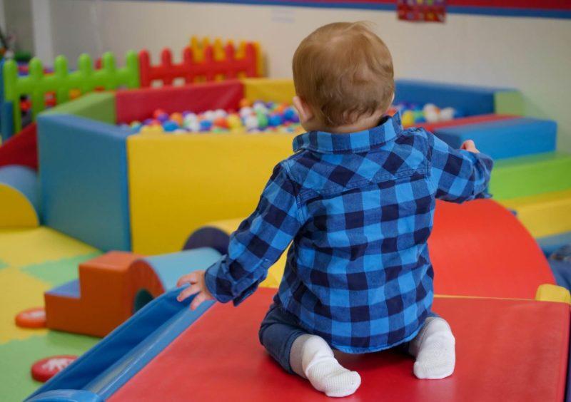 toddler playing on indoor slide
