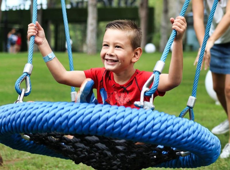 child on outdoor swing
